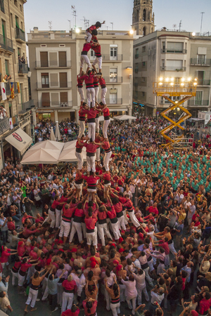 Reus, Spain - October 03, 2009: Castells Performance, a castell is a human tower built traditionally in festivals within Catalonia. This is also on the UNESCO Intangible Cultural Heritage of Humanity