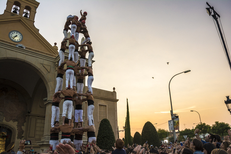intangible: Reus, Spain - September 25, 2014: Castells Performance, a castell is a human tower built traditionally in festivals within Catalonia. This is also on the UNESCO Intangible Cultural Heritage of Humanity