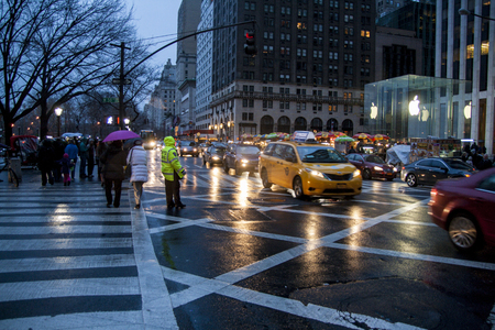 5th: New York City, USA. December 09, 2012. RAiny evening view of the 5th ave in NYC. Editorial