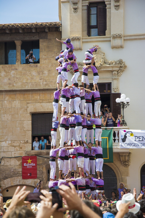 intangible: Vilafranca, Spain - August 30, 20141: Castells Performance, a castell is a human tower built traditionally in festivals within Catalonia. This is also on the UNESCO Intangible Cultural Heritage of Humanity