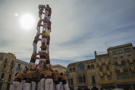 REUS, SPAIN - OCTOBER 25, 2014: Castells Performance, a castell is a human tower built traditionally in festivals within Catalonia. This is also on the UNESCO Intangible Cultural Heritage of Humanity
