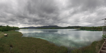 cristal: Aerial panorama view of Lake Banyoles. Mirrored clouds on the cristal clear water.