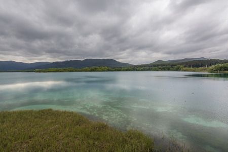 cristal: View of Lake Banyoles. Mirrored clouds on the cristal clear water.