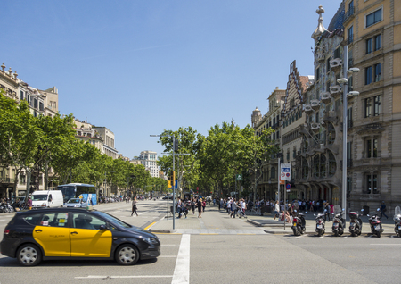 taxi famous building: BARCELONA, SPAIN - MAR 15, 2014: Architecture on the Passeig de Gracia in Barcelona, Spain. Its one of the most important shopping and business areas in the city
