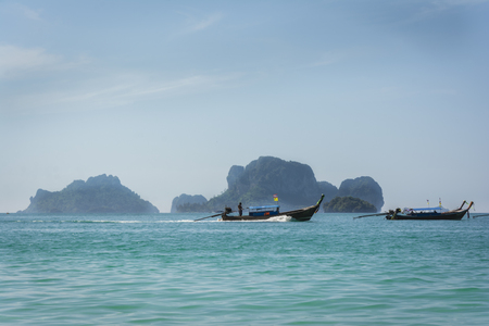 A longtail motor boat in blue tropical waters, Railay beach in Thailand. Stock Photo