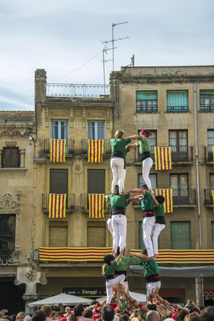 intangible: Reus, Spain. October 25, 2014: Castells Performance, a castell is a human tower built traditionally in festivals within Catalonia. This is also on the UNESCO Intangible Cultural Heritage of Humanity Editorial