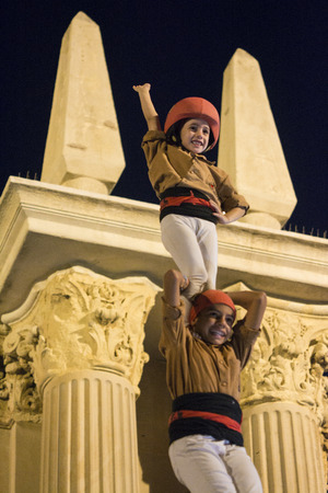 intangible: Reus, Spain. september 25, 2014: Castells Performance, a castell is a human tower built traditionally in festivals within Catalonia. This is also on the UNESCO Intangible Cultural Heritage of Humanity