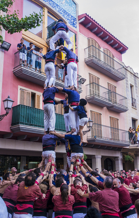 traditional climbing: Cambrils, Spain. September 05, 2016: Castells Performance, a human tower built traditionally in festivals within Catalonia. Editorial