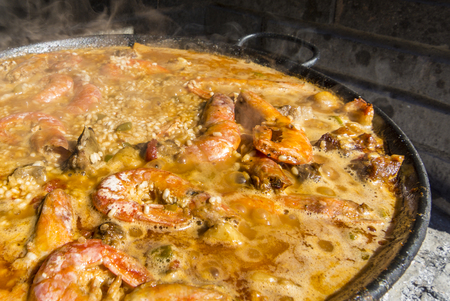 valencia orange: Spanish paella, a famous typical spanish rice dish.