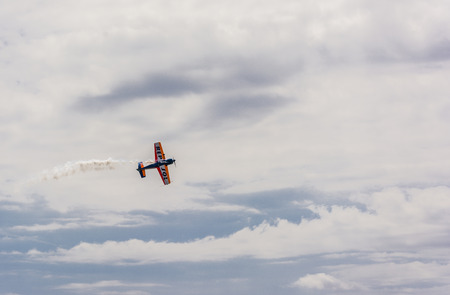 reputed: Tarragona, Spain - April 29, 2017: Repsol Bravo3 team show in Tarragona. Bravo3 airshows combine synchronized flight of two aircraft, or formation flying, combined with aggressive Freestyle manoeuvres, making performances reputed to be some of the most or