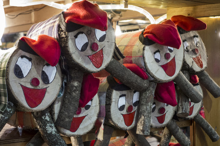 Tio de Nadal, a traditional Christmas symbol of Catalonia, Spain. Christmas decorations on the Santa Llucia market in Barcelona Banco de Imagens - 77283293
