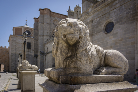 Old statue of a lion in Medieval European Town of Avila, Spain. The old city of Avila and its extramural churches were declared a World Heritage site by UNESCO