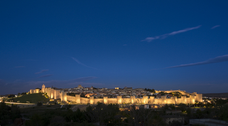 Panoramic view of the historic city of Avila,at the blue hour, in Spain. the old city of Avila and its extramural churches were declared a World Heritage site by UNESCO