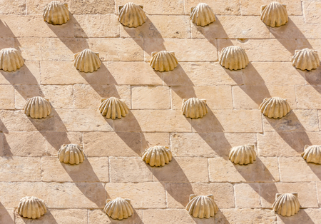 detail of the shells in Casa de las Conchas in Salamanca, Spain. exterior image shot from public floor. The Old city of Salamanca is declared by UNESCO a World Heritage Site.
