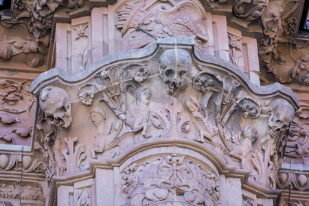Detail of the facade of University of Salamanca in plateresque style and the famous frog on a skull. Stock Photo