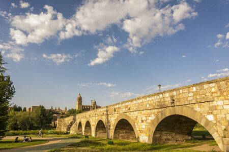 salamanca: Ancient Roman bridge with the New Cathedral in the background in Salamanca, Spain Stock Photo
