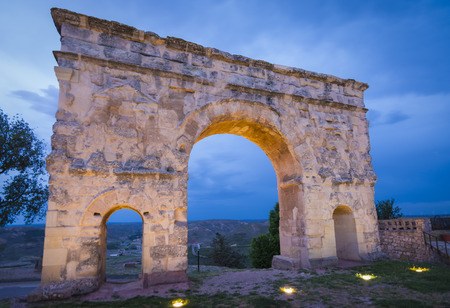 castilla: Roman arch of Medinaceli, from 2nd-3rd century AD in Soria province, Castilla-Leon, Spain. Blue hour shot.