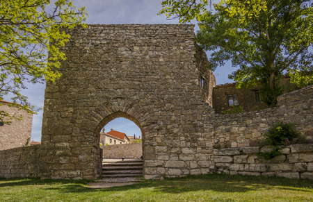 castile: Arab gate on the walls of Medinaceli. Medinaceli is an ancient and historic town in the province of Soria, in Castile and Leon, Spain. Stock Photo
