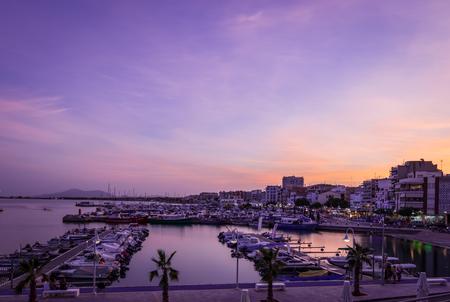 ebro: Sunset or blue hour in quiet port of lAmpolla, Delta del Ebro in Spain. Mediterranean Sea