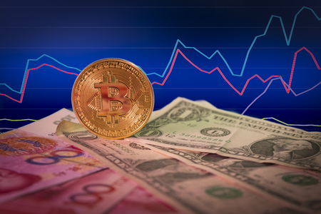 Financial growth concept with golden bitcoin above dollar and yuan bills and chart background. Stock Photo