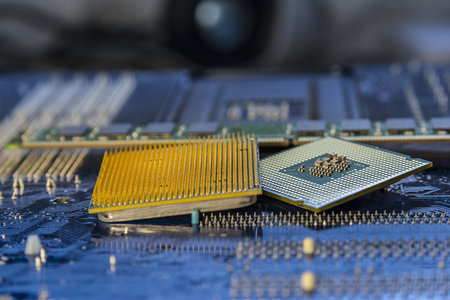 processors: Technology background with computer processors CPU concept and blue circuit, board texture. Stock Photo