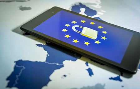 Padlock and EU flag inside smartphone and EU map, symbolizing the EU General Data Protection Regulation or GDPR. Designed to harmonize data privacy laws across Europe.