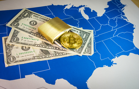 Bitcoin and padlock over US dollar blls and map.Situation of Bitcoin and other cryptocurrencies in USA concept