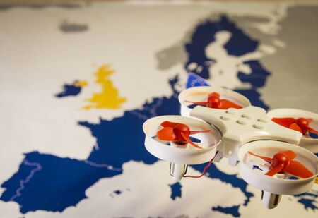 Mini drone flying over a EU map. European rules for drone aerial aircraft law concept
