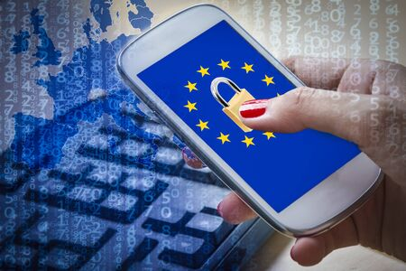 Padlock and EU flag on smartphone screen and female hands using it. Suitable for the EU General Data Protection Regulation GDPR or the NIS Directive of cybersecurity
