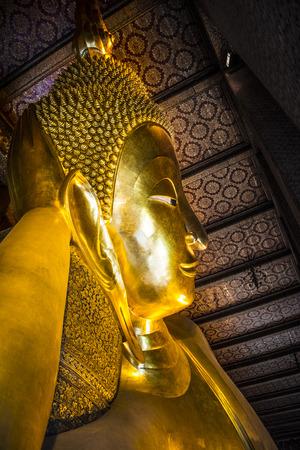 Giant reclining buddha at Wat Pho Temple in Bangkok, Thailand Stock Photo