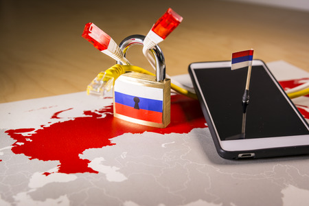 Padlock, net cable, Russia flag on a smartphone and Russia map.