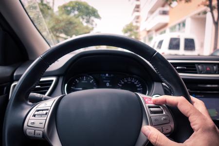 Man hand touching an e-call button in the car