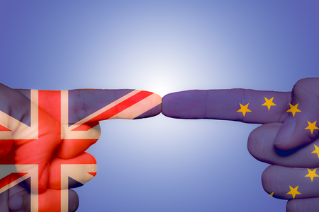 Two different hands touching each other by index finger, Brexit concept