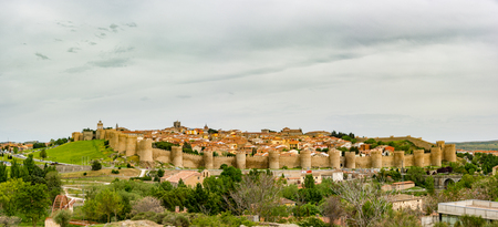 Panoramic view of the historic city of Avila, Spain with its famous medieval town walls surrounding the city at sunset. UNESCO World Heritage. Called the Town of Stones and Saints Stock Photo