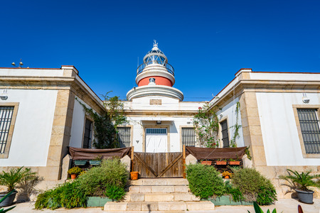 Old lighthouse of Salou in Costa Daurada. Mediterranean sea coast in Spain.