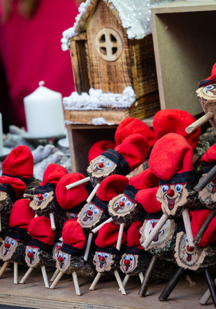 Handmade tio de nadal, a typical christmas character of catalonia, spain, on sale in a christmas market
