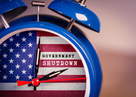 Retro alarm Clock with American Flag and government shutdown message Stock Photo