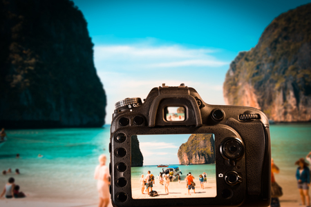 DSLR camera focus on Maya Bay in Phi Phi Islands. Thailand