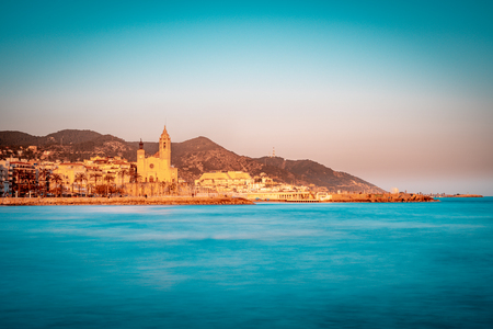 Blue hour view of mediterranean town of Sitges in Barcelona province. Spain.