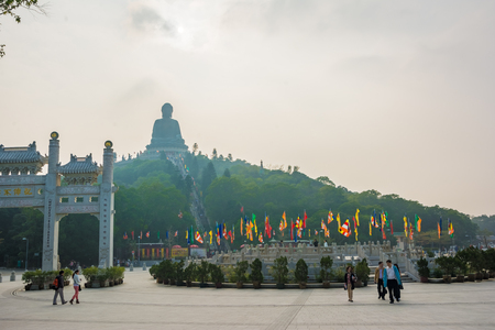 Hong Kong, China - Dec.2013:The large bronze statue of Buddha Shakyamuni known as Tian Tan Buddha is 34 meters tall and weighs over 250 tons. Ngong Ping Piazza and Big Buddha view