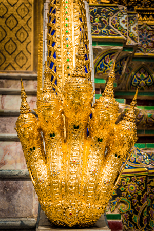 Golden 5 head naga serpent on staircase at Grand Palace Wat Phra Kaew in Bangkok Stock Photo