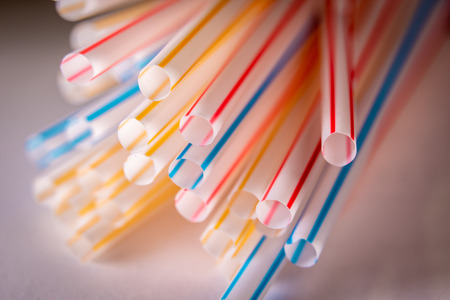 Background of Colored plastic straws, macro shot.