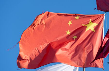 Chinese flag waving in the wind on a sunny day