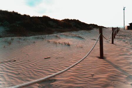 White sand dunes at sunset in a mediterranean beach