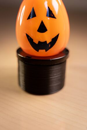 Smiling halloween Pumpkin isolated against a blurry background