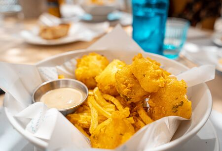 Real fish and chips with french fries ina restaurant Banco de Imagens