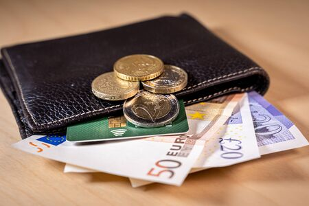 Brexit Financial concept with a wallet with Euro and Pound bills and coins