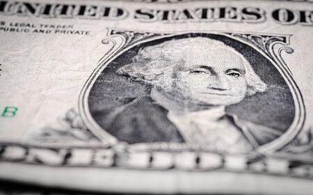 one dollar bill focused on Washingtons eyes