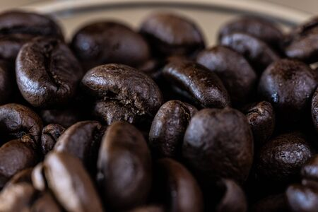 Macro view of roasted coffee beans inside a glass jar Banco de Imagens