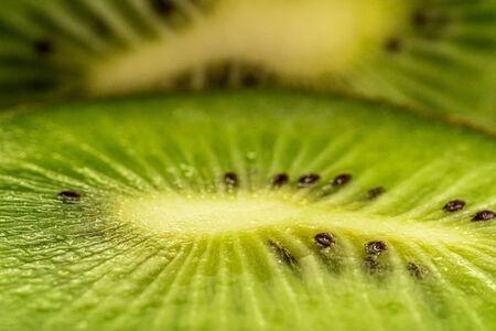 Macro shot of a kiwi slice. Healthy food